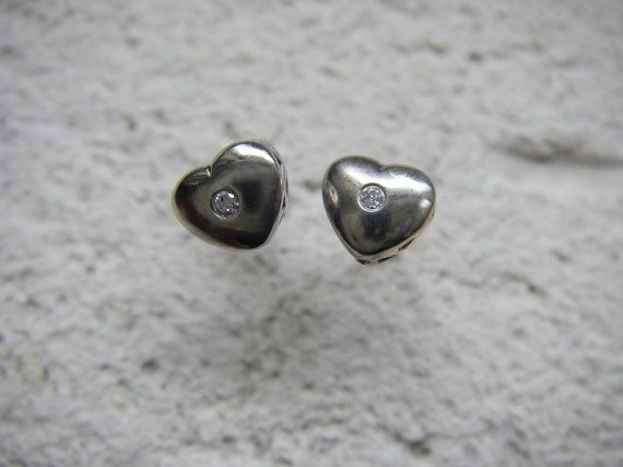 White gold heart stud earrings with diamonds by SlashpileDesigns, These dainty white gold hearts were reclaimed from an antique gold bracelet that was melted down for the metal. The hearts each feature a sparkly little diamond, and are soldered onto white gold posts. These earrings would be a perfect Valentine's day gift, and look amazing for everyday wear.