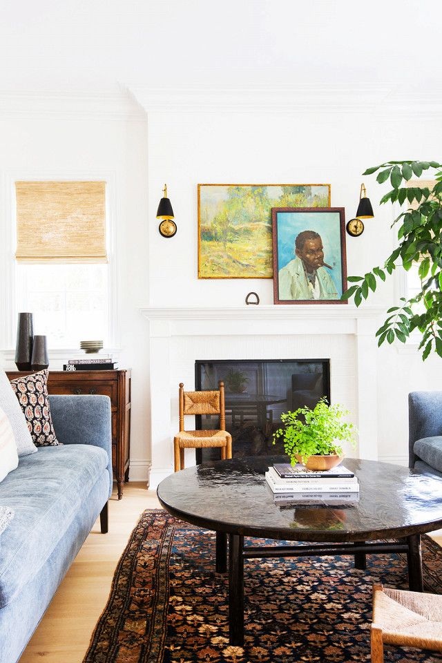 Lewis loves to pack a space with texture and color. While her selection of rugs and pillows certainly deliver this in a space, artwork is also key. This home combines a mix of vintage paintings...