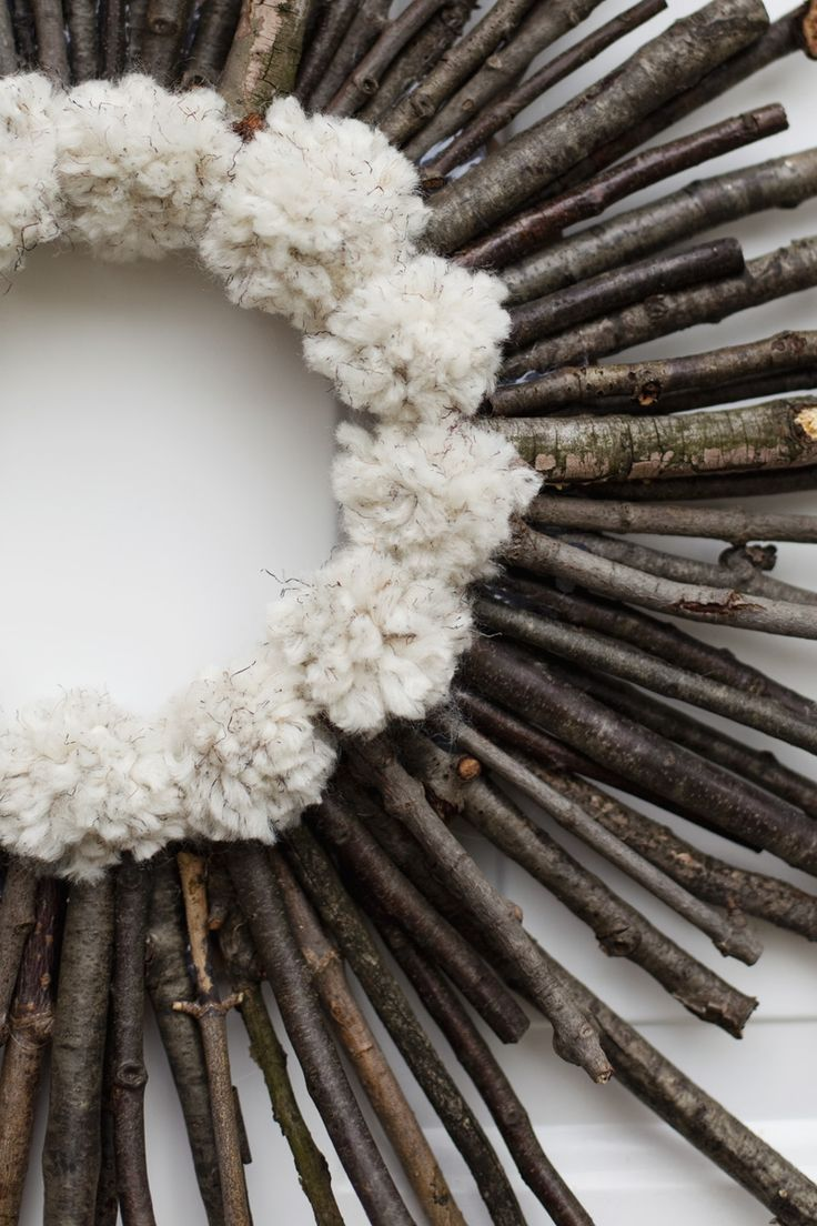 make it with driftwood and moss ...Make a twig and pom pom starburst wreath— It's practically free!