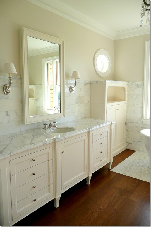 Calacatta marble countertop and on the walls.  Love it with the wood floor.