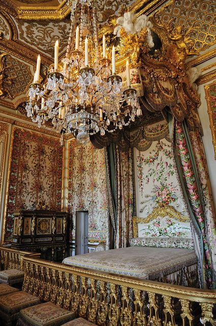 Queen's bedroom at Versailles as it was last decorated during it's use by Marie Antoinette. The door visible in the corner  is the secret passage she used to escape rioters during the French Revolution. MISC