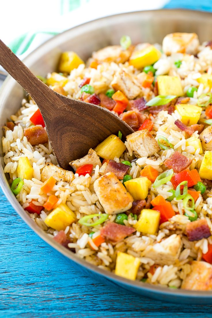 This recipe for pineapple fried rice is loaded with chicken, bacon, crunchy veggies and juicy pineapple. A simple and easy main course or side dish.