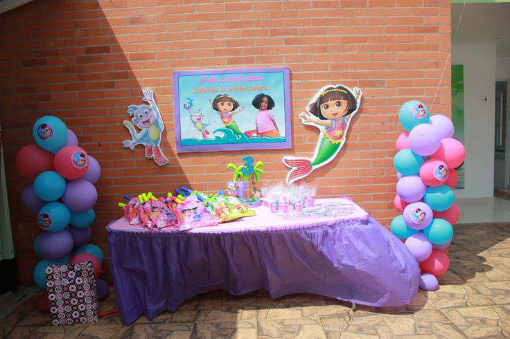At my baby #girl 's Dora Mermaid Adventure pool birthday party, this was the #table #decoration for the favors. I made and printed party sign, Dora mermaid, Boots, and stickers; also made the #balloon stands for the first time using broom sticks. #doratheexplorer #doralaexploradora #dora #explorer #exploradora  #mermaid #sirena #adventure #reino #mermaidadventure #pool #piscina #party #fiesta #partyideas #ideas #crafting #kids #kidsbirthdayparty  #birthday #birthdayparty #decorate…