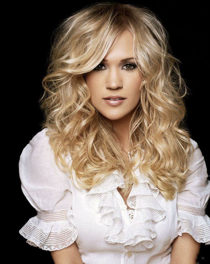 Carrie Underwood:  nothing I don't love about her. The voice, the hair, the makeup. Gorgeous