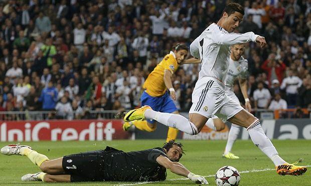 Cristiano Ronaldo skips around Gianluigi Buffon to open the scoring.
