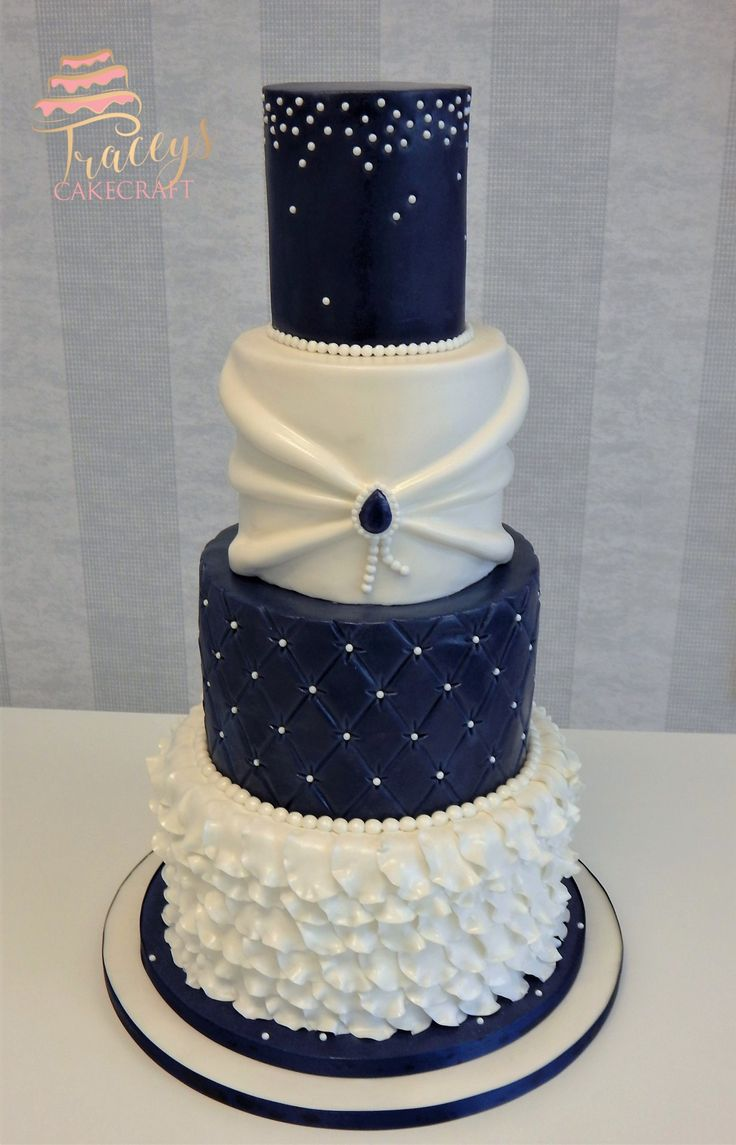 Navy & white wedding cake, petal ruffles, quilting and ...