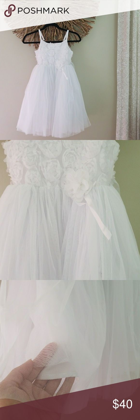 White Dress Dreamy, 'fluffy' tulle white dress for your princess. Perfect for a communion, flower girl, angel costume, or any special occasion requiring the perfect white dress💛   Dress is in very good condition. Worn once for about an hr. However there is a pink spot (not very visible) by the top of the dress, and there's also a frayed spot in the same area, both flaws shown in picture above, & both, easily remedied.  About 27 inches long from neck to bottom. Dresses Formal