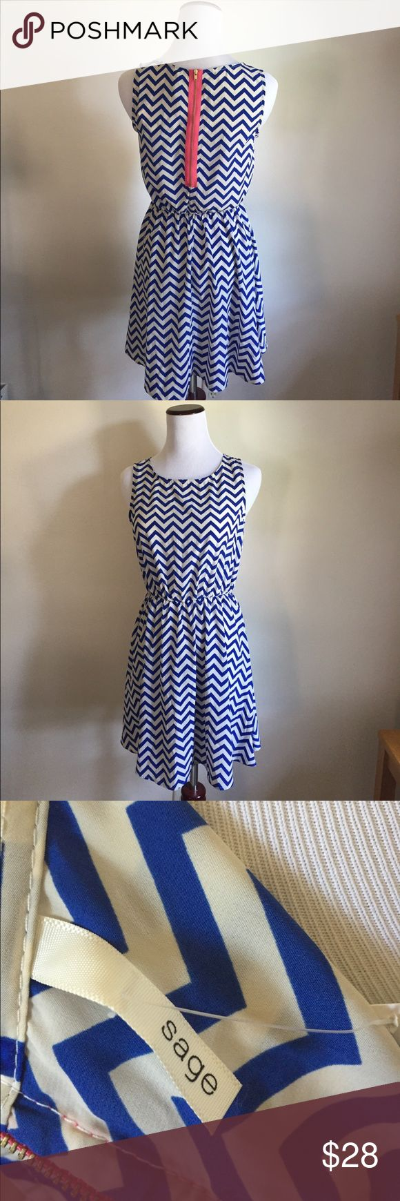 Blue chevron dress Love the exposed pink zipper on the dress.  The blue and white chevron dress is perfect for brunch or an afternoon wedding.  Pet friendly home. Sage Dresses