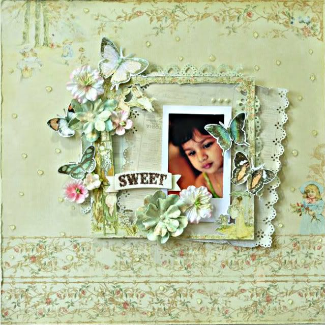 A layout featuring Prima patterned papers & flowers with fussy cut butterflies from Bo Bunny patterened papers