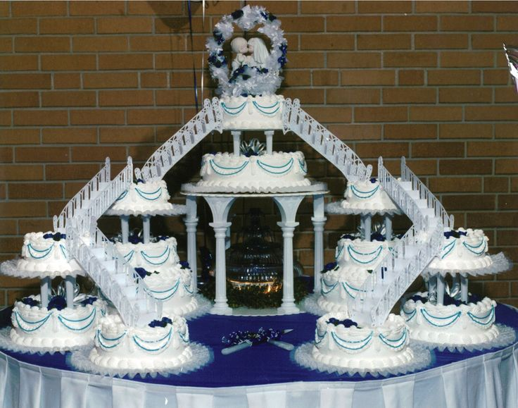 mc arthurs wedding cake with fountains and bridges- with a different topper