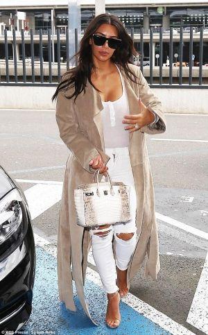 Kim Kardashian wearing Hermes Himalayan Birkin Bag, J Brand 620 Distressed Jeans in White Rocks, Yeezy Season 2 Lucite Heel Sandals and Alix Horatio Henley Bodysuit