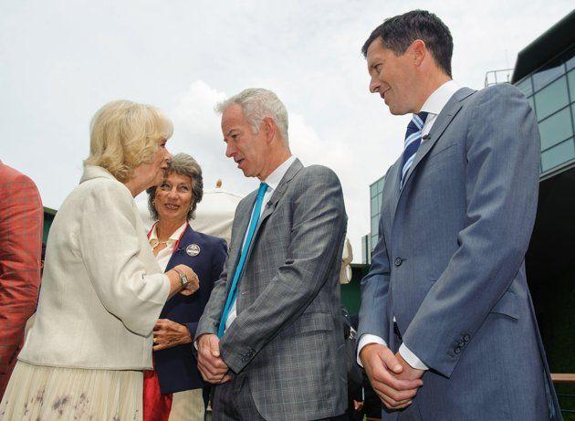 The Championships - Wimbledon 2013: Day Four. John McEnroe and Tim Henman looking sharp gentlemen!