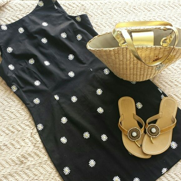 Outfit bundle Beautiful black dress with daisy stiched detail, excellent condition, zipper down back goes about 3/4 ths of the way down size 12P, comes with brand new Nine West woven purse with sequin detail and GOREGOUS Skemo sandals with crystal accents size 6 made in Indonesia retail $150 Dresses Mini