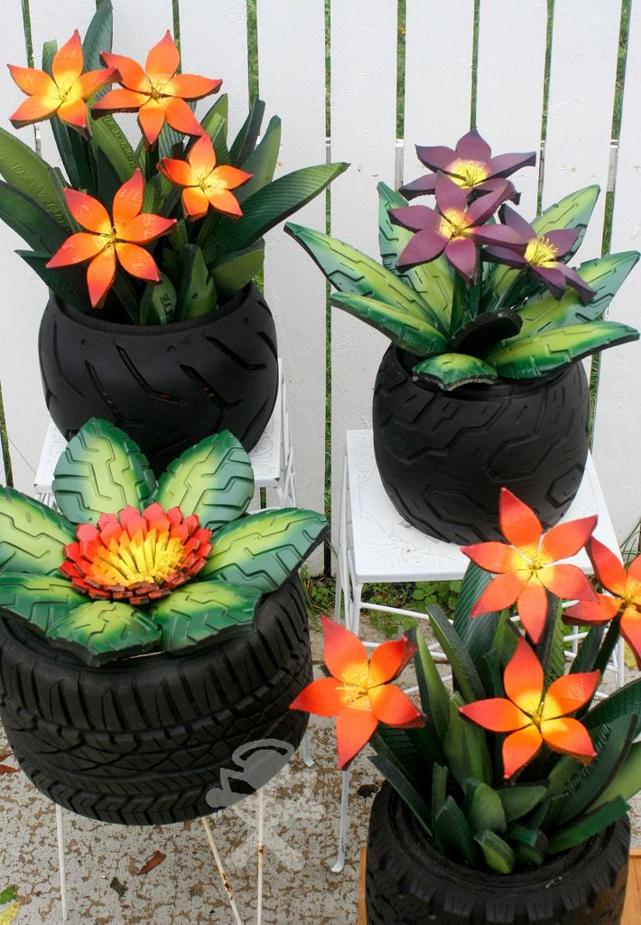 I use old tires, cut them up, paint them, and make flowers with them.
