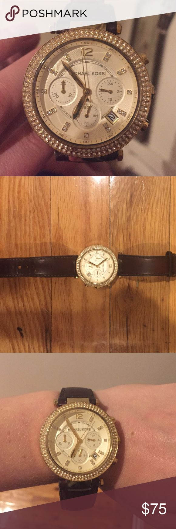 Michael Kors leather band watch Michael Kors leather band watch with gold and diamond accents throughout the watch. One slight issue is one of the round ends on one band has fallen off. Easily replaceable though! Michael Kors Accessories Watches