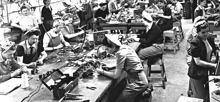 Women soldering and assembling cables for airplanes---Vetrans Affairs Canada, govenment website making it reliable---The war helped Canada's economy. It gave people jobs and made Canada the third largest trading country in the world. They produced many war goods such as aircraft and munitions.