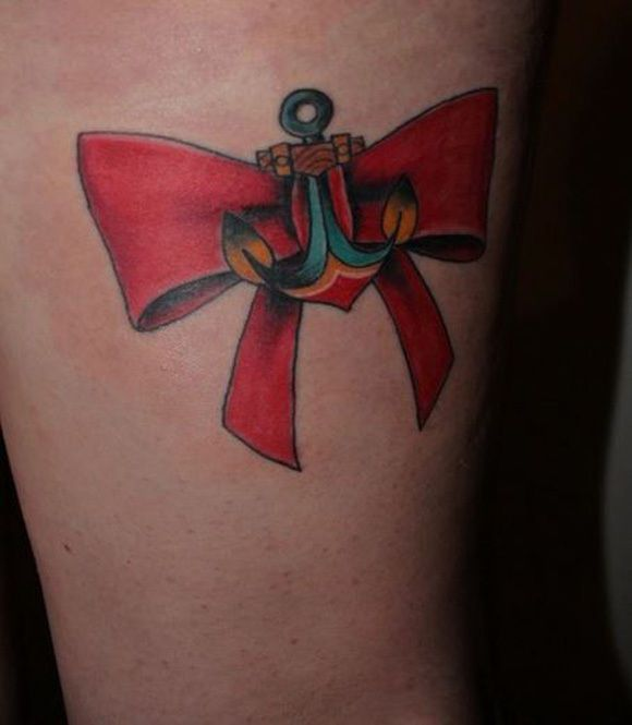 Amazing anchor tattoo with beautiful red ribbon.