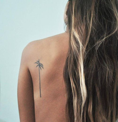 Palm tree tattoo on Amelias shoulder blade.