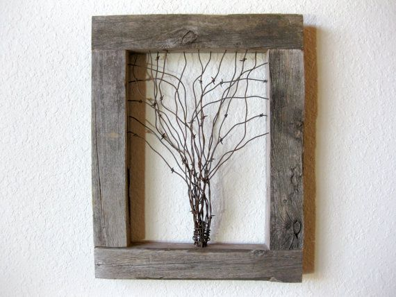 Approximate Size: 18 (w) x 22.875 (h) x 3 (d) ~ Frame is 3 wide  This thick rustic barn wood frame and barbed wire tree wall art is sure to compliment your home. Made from reclaimed barn wood from Phlox, Wisconsin from the now retired farm that has been in my family for 4 generations. Youll see and feel the history in the natural distressing that years of harsh Wisconsin weather created. Beautiful vintage barbed wire is wound together then shaped into a lone tree like those found in open…