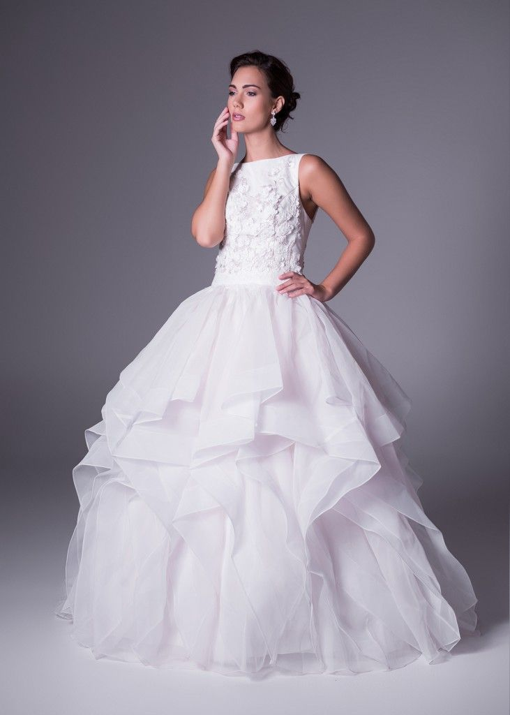 Step out in style. This soft white #organza ruffle ballgown #wedding dress with lace bodice was designed by style icon, Oleg Cassini. Click to Book a Free Fitting in this Dress.