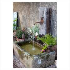 lovely old cement trough with brass tap to create a water fountain