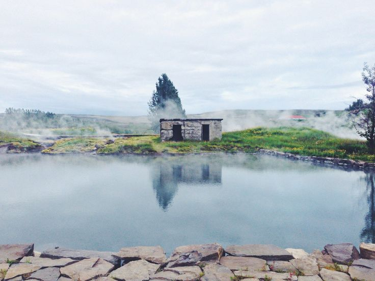 a natural geothermal pool in the raw Icelandic nature, Gamla Laugin also known as the Secret Lagoon