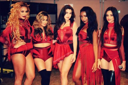Fifth Harmony - In this photo they are all wearing the same colour but in different styles, this shows their individuality and how their styles differentiate from each other, but even though they bare different, together they are talented and work well within their group.