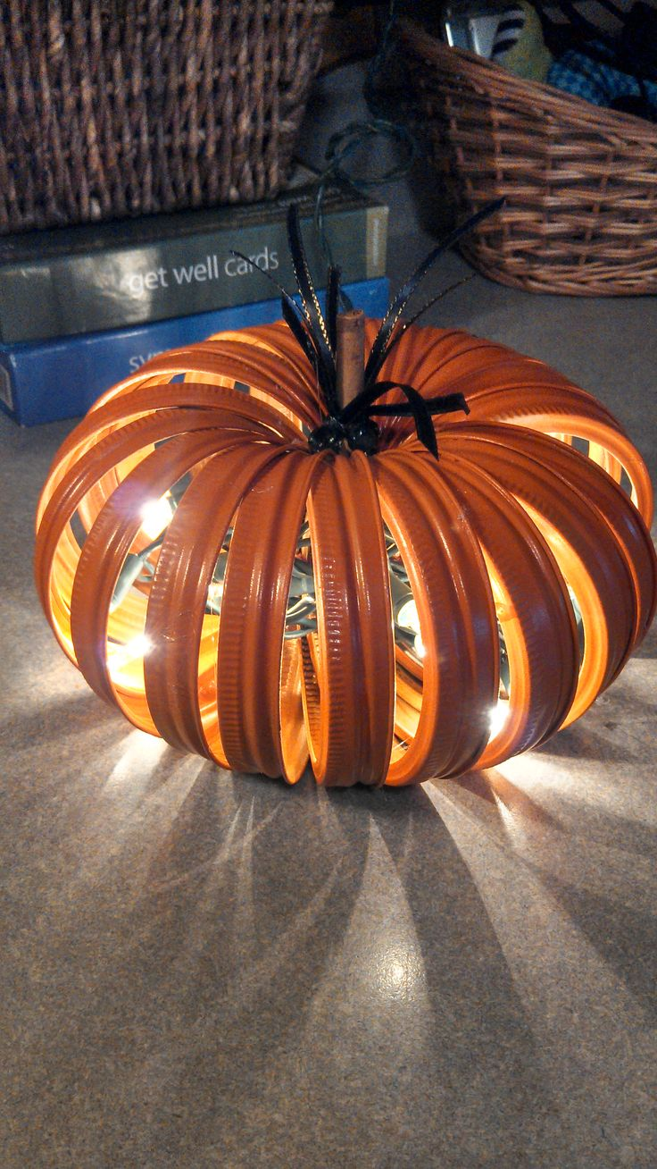 Pumpkin made from Canning Jar Lids...Really cool with lights in it...going to have to try this!!