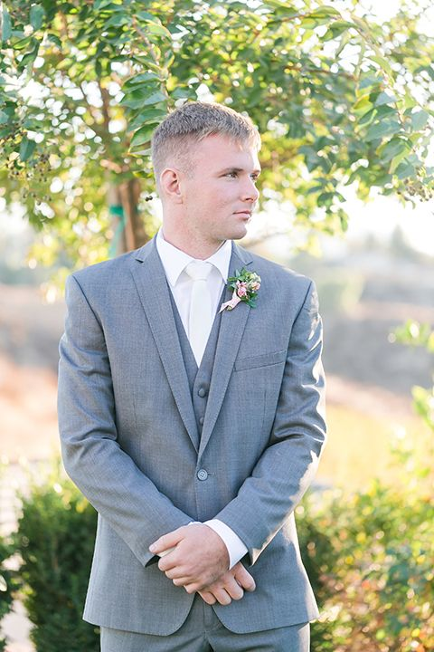 79af7dcc1b0d Temecula outdoor wedding at bel vino winery groom grey notch lapel suit  with a matching vest and white dress shirt with a long white tie and white  and pink ...