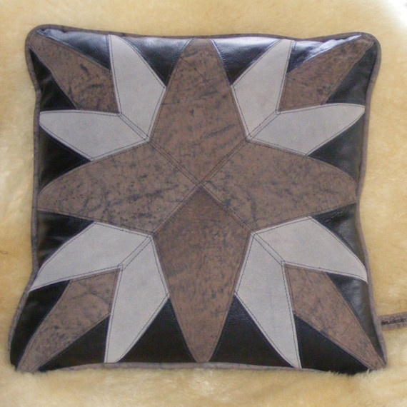 "*One of my most popular designs,    * will fit in western decor or ever mariner decor , depending what it looks like to you    *18"" and has a mate with opposite colors (see gray  starburst 2)    * has black microsuede back with zipper closing. $85"