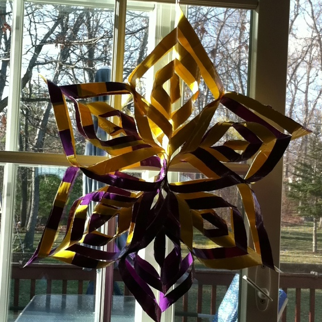 """""""I made a purple and yellow Duct tape star ornament. Indestructible for outside use!!"""""""