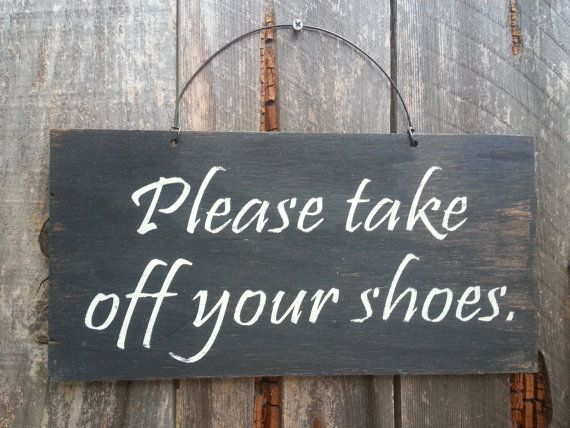 """My sign says """"The shoes stop here!"""" I ask everyone to remove their shoes in my house. Due to allergies and asthma, the less dust and dirt dragged in the better. I supply footsies for people to wear. I also provide shoe covers for those who resist removing their shoes."""
