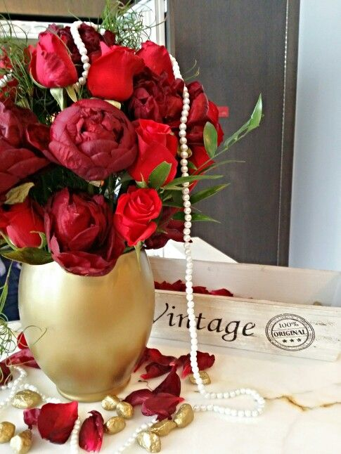 Classic glam bridal shower red centerpiece.