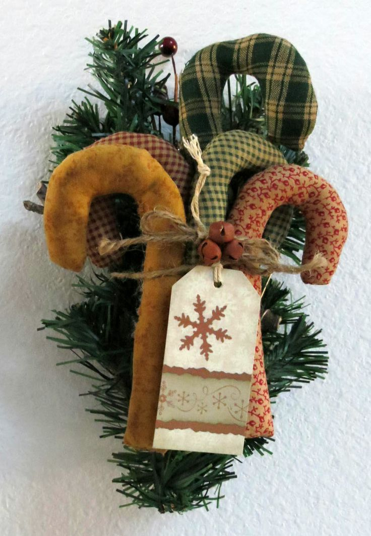 103 best candy canes images on pinterest christmas decor five primitive candy canes greenery berries tiny rusty bells and a christmas tag publicscrutiny Choice Image
