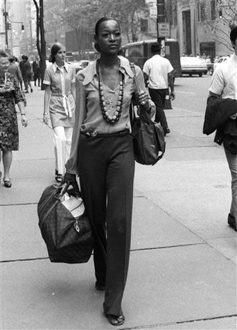 Naomi Sims, model, carrying a LV Keepall, 1969.