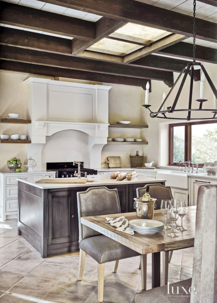 Mediterranean Cream Kitchen with Exposed Beams