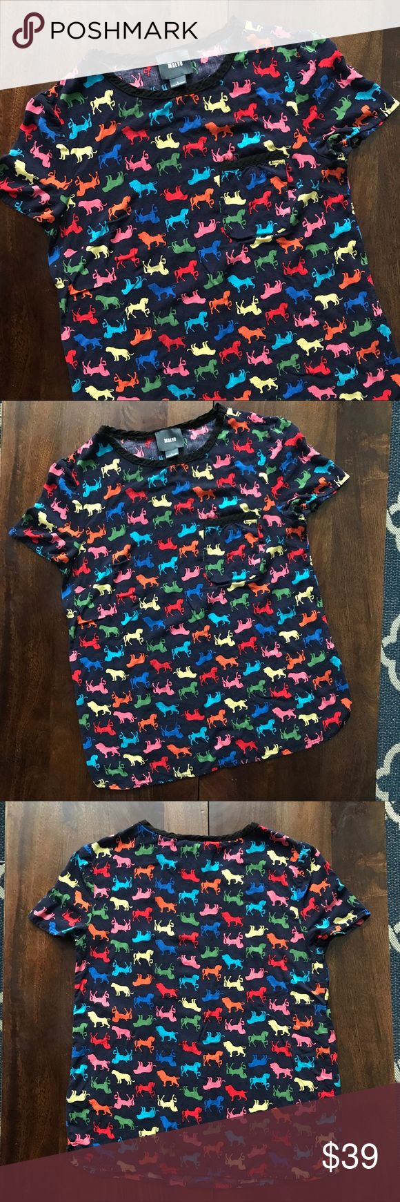 """Anthropologie • carousel horse and lion tee Anthropologie • Maeve • navy tee with colorful carousel horses and lions • so soft! • all measurements were taken with the garment flat and are approx : pit to pit 17""""   length 23.5"""" Anthropologie Tops Tees - Short Sleeve"""