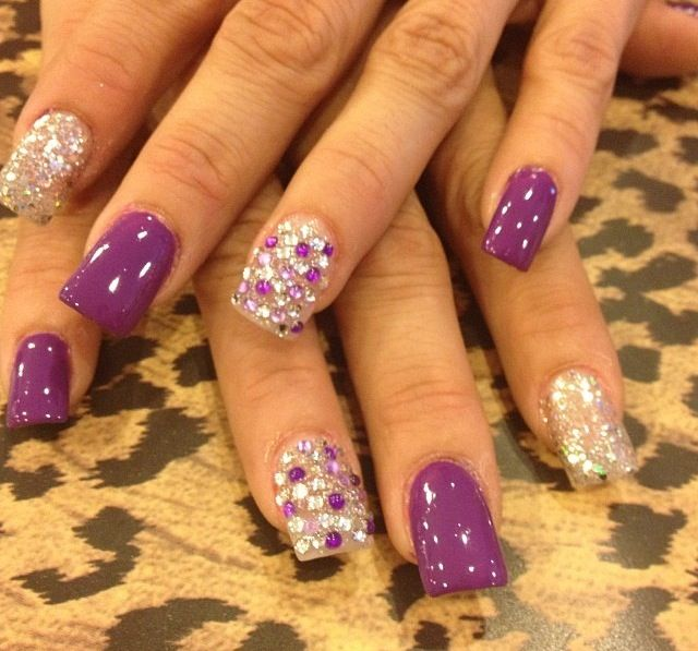 Purple nails with jeweled nail