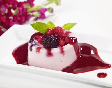 Mixed Berry Dessert Sauce Is the Berries: Mixed Berry Sauce on Panna Cotta