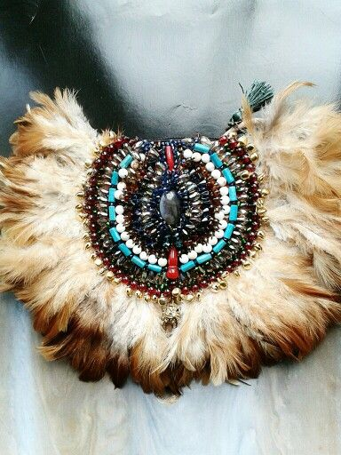 Feather mini satchel bag by Anita Quansah London for AfrikHai featuring multi coloured beads and feathers. Contact@anitaquansahlondon.com
