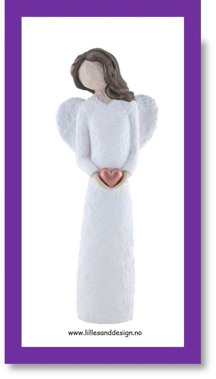 Handmade in Lillesand, Norway. A beautiful angel, 33 cm in height, a wonderful sculpture. https://www.lillesanddesign.no/produkt/engel-33-cm-holder-kobberhjerte-farge-hvit-brunt-har/