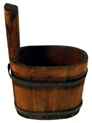 Piggins are often described as small wooden buckets and like ladles, were used for dipping liquids.The staves are bound with straps of iron.    Piggins usually had lids, but with time the lid was often lost or destroyed.    The elongated stave which serves as the handle is the distinguishing feature of a piggin.