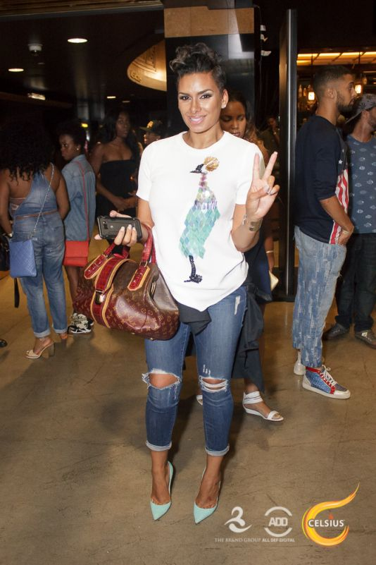 Laura Govan chucks up the deuces on her way into the All Def Comedy Live party inL.A.