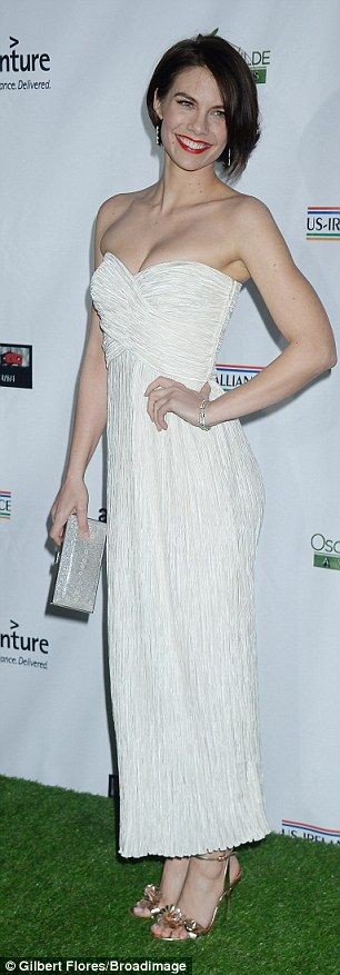 The 35-year-old Walking Dead star dazzled in a strapless cream crepe gown, which flaunted ...