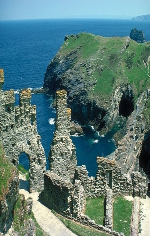 Tintagel Castle ruins of the Arthurian Legend steeped in legend and mystery; said to be the birthplace of King Arthur and Merlin's Cave. Cornwall, England.