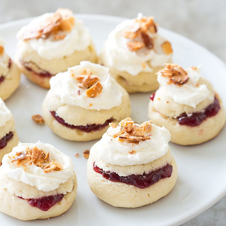 These Raspberry-Filled Almond Torte Cookies get a double-dose of almond flavor with a crunchy almond topping and almond extract in the frosting.