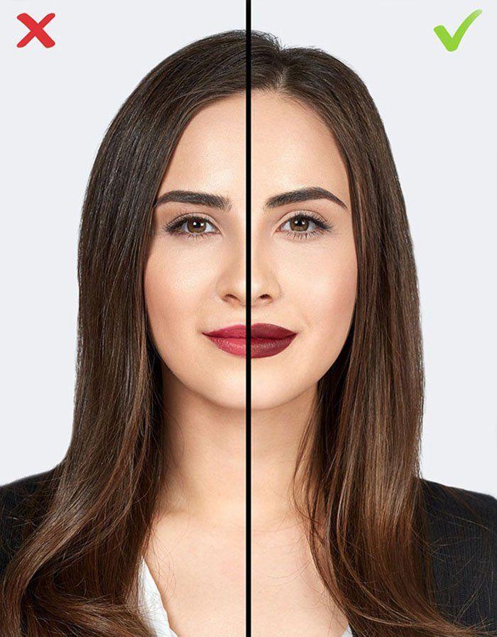 mujer cabello largo y saco negro y labios pintados