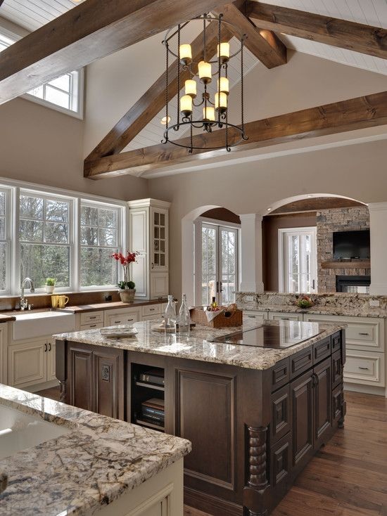 Beautiful two-tone kitchen with vaulted ceiling beams, wood floors, wood and granite countertops, antique white, brown wood, archways, wow! Blue Marlin Court by Echelon Custom Homes