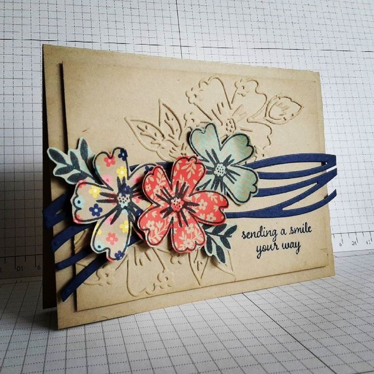 handmade greeting card: Sending a smile by Evee's aunt ... kraft ... trio of flowers from Love and Affection suite ... stamping on patterned paper ... luve the embossing folder lines for the same flowers ... Stampin' Up!