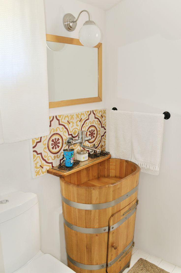 Washbasin at The Nest, complete with a wooden barrel turned into cabinet at Catherine's Vineyard Cottages in Csákberény, Hungary.